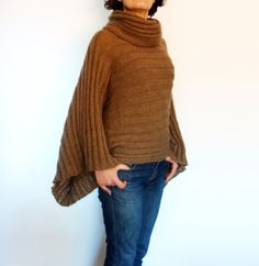 This distinctive poncho with the dramatic kimono sleeve and rolled collar can be an all season knitwear Knit this elegant sweater/poncho for yourself or as a gift for your loved one! Unique designs for unique women! Skill level: beginner. Skills required: basic knit stitches. Size: S, M, L, XL Materials: - circular knitting needles size 5mm - DK yarn.  *************************** INSTANT DOWNLOAD. Price is for the PATTERN only, not the finished product. Once payment has cleared, you will...