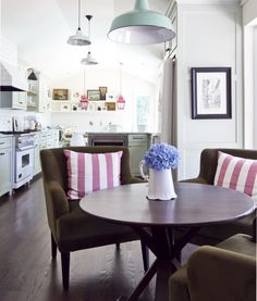 kitchen in middle, banquette on one end, small dining table on other