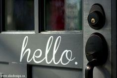 hello painted sign on door