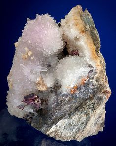 Lovely Amethystine Quartz with Pyrargyrite, Prousite and Acanthite crystals on matrix! This is a classic Silver specimen with a beautiful display. There's a good bit of red still showing through in the Pyrargyrite and Prousite crystals. They're in great shape as well. From St. Joachimsthal, Erzegebirge, Czech Republic. Measures 6 cm by 5 cm by 3 cm in total size. Price $985