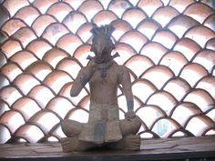 Statue from Yucatan in window