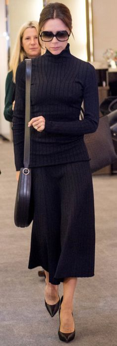 VB's Sunglasses by Cutler & Gross, Sweater & pants by Victoria Beckham Collection.