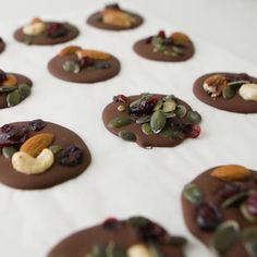 Dark chocolate discs topped with a trail mix. A super simple and healthy snack idea. Grab straight from the fridge when your sweet tooth is acting up. Sweet Recipes, Snack Recipes, Dessert Recipes, Cooking Recipes, Chocolate Candy Recipes, Homemade Chocolate, Healthy Chocolate Snacks, Kreative Snacks, Tasty