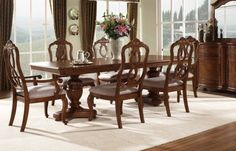 Elegant Design For Dining Room With Flower Arrangements Above Square Table And White Extra Large Rugs Under Unique Chair Also Using Wood Flooring