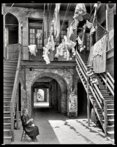 "New Orleans circa 1937. ""Courtyard at 1133-1135 Chartres Street."" Young and old, hangin' with the laundry."