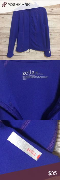 Zella Workout Jacket Flawless like-new condition jacket by Zella in a beautiful bluish-purple color. Double front-zip. One front pocket and two interior pockets. Long sleeve. Collar can be zipped all the way up or left open. Perfect for working out or all the time! Zella Jackets & Coats