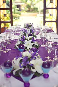 Purple and teal color scheme perfect for a fun wedding - Purple and teal centerpieces ...