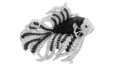 Collection Seven Seas de Van Cleef and Arpels. Clip Nageur de Van Cleef & Arpels en or blanc, diamants, saphirs taille cabochon, spinelles noirs et onyx