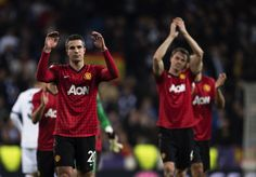 Manchester United's Dutch striker Robin van Persie (L) applauds supporters at the end of the UEFA Champions League round of 16 first leg football match Real Madrid CF vs Manchester United FC at the Santiago Bernabeu stadium in Madrid on February 13, 2013. The match ended in a 1-1 draw
