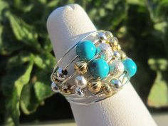 Turquoise Memory Wire Ring with Stardust, Gold and Silver Spacers. $5.00, via Etsy.