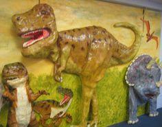 School children study dinosaurs in school.