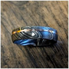 New Wide Damascus Steel Ring with Solid Rose Gold Inlay Custom Jewelry, Jewelry Art, Unique Jewelry, Damascus Wedding Band, Thing 1, Damascus Steel, Jewelry Companies, Types Of Metal, Wedding Bands
