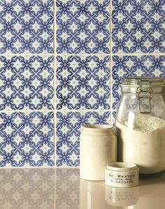 Villette tiles on a Papyrus background in a combination of white and deep blue - a classic combination. Handmade ceramic tiles from the Chateaux collection by The Winchester Tile Company. winchestertiles.com
