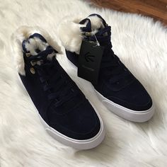 Burnetie blue sneakers w/ fur Gorgeous womens booties/sneakers. Have a fun white faux fur detail. Blue suede. Offers welcome through offer tab. No trades. Size 37 european, US 6. Burnetie Shoes Sneakers
