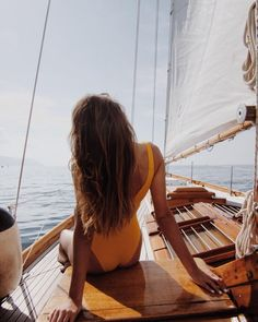 love everything about this photo: the one piece, the hair, the boat, the ocean