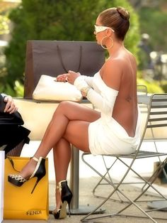 Stunning shapely legs in high heels and short backless dress.
