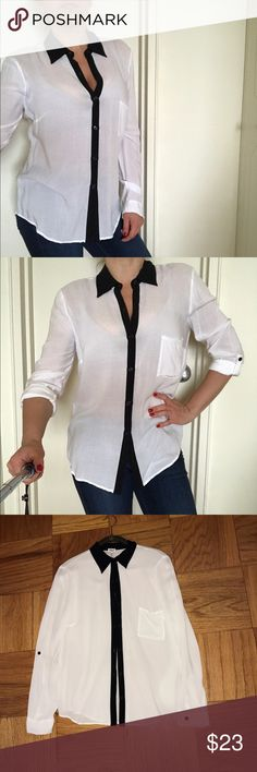 Splendid white and black blouse button down shirt Splendid white and black blouse/button down shirt. Size Small. Super soft and light material. Feels like you're wearing nothing at all. Long sleeves roll up for a casual look. Pre-owned condition. Very Small barely noticeable light stain on the back may come out with wash. Splendid Tops Blouses