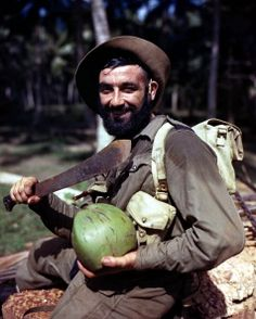 January, 1945, Sri Lanka, Asia, A Marine commando soldier holding a large knife prepares to quench his thirst with milk from a coconut during jungle training.