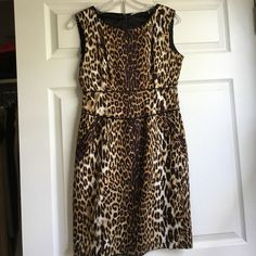 Tahari leopard print dress size 2 LIKE NEW Worn ONCE for a formal occasion. Really flattering bc of the far leopard print that runs down the middle of the dress. Form fitting. Size two but runs a little larger than regular size 2. Tahari Dresses Midi
