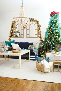 Creating a Classic Christmas Decor with Blue Accents: Look at this gorgeous living room dressed up for the holidays by Jennifer Bridgman of The Chronicles of Home. So elegant!   @chrniclesofhome