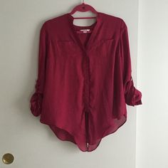Magenta blouse Beautiful magenta blouse with button up detailing, a tie on the bottom of the front (as pictures) and lace detail on the back. Super cute!! Candie's Tops Blouses