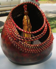 Dyed Red Gourd with Coiled pine needles and tassel. $250.00, via Etsy.