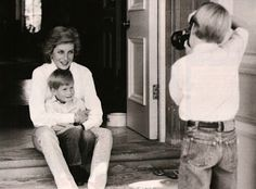 William taking a photo of his mother and Harry.