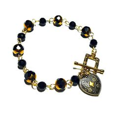 Only $6.99! - SALE Black & Gold Glass Cathedral Beads Linked Bracleted w/Vintage Style Bronze Filigree Heart Charm & Gold Filigree Rectangular Toggle - Under $10 Bracelet - FREE USA SHIPPING https://www.etsy.com/listing/399844689/sale-black-gold-glass-cathedral-beads  #CathedralBeads #CathedralBracelet #GoldBlackLinkedBracelet #EtsyJewelrySale #HugeJewelrySale  #EtsyJewelryShop #DIYJewelry #DYIbracelet #BronzeFiligreeHearts