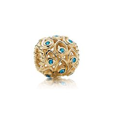 Ocean treasures - Gold charm in 14k gold with blue topaz. $400 #pandora #charm #jewelry #gold #topaz #joyeria #oro