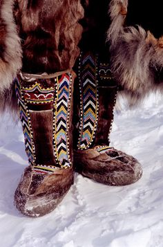 A pair of traditional Dolgan women's reindeer skin boots decorated with ornate bead work. Taymyr, Northern Siberia, Russia.