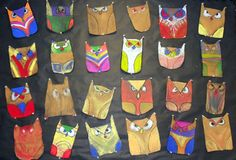 3rd grade project...Symmetrical Owls from Art Projects for Kids. Loved the colors the kids came up with!
