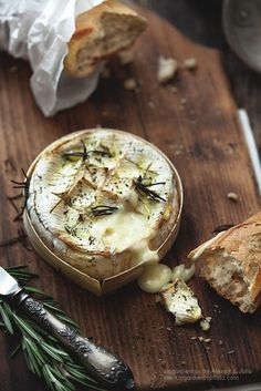 Rustic Food Series: Crusty Baguette with Baked Brie & Rosemary - No real recipe required - just get a nice round of brie, score the top and brush with a bit of egg wash. Sprinkle some salt and rosemary leaves on top. Bake for 10 minutes or so until cheese is hot and melty. Pull apart crusty baguette and dip.