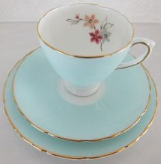 Vintage Delphine Bone China tea set - duck's egg blue/aqua on the outside, white inside and handles with posy in pinks and blue, gilt on rims and handles.  Date from 1930-1940.