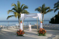 wedding arches | As shown with matching floral baskets also used on buffet and ...