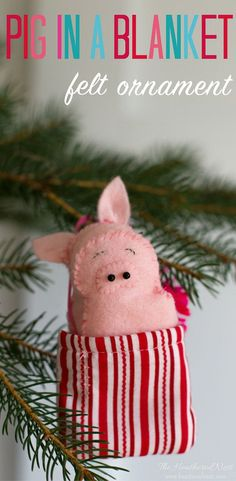 "Precious ""Pig in a blanket"" DIY felt pig ornament. The pig is removable from it's blanket. Super cute pig ornament for Christmas!! #pig #feltornaments #pigornament #feltchristmasornaments #animalornaments #DIYornaments #easyfeltornaments #feltornamentsfor"