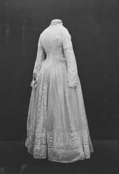White silk bodice and skirt with embroidered muslin overdress, pleated-front bodice, long sleeves, full bell-shaped skirt. Embroidered in wh...