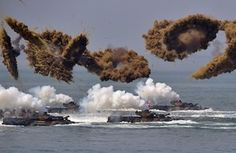 South Korea: Amphibious vehicles fire smoke shells during a re-enactment of the…