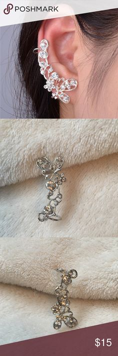 Butterfly Ear Climber Silver alloy hypoallergenic butterfly ear climber. Featuring a single butterfly positioned at the pierced portion of the ear with a floral vine climbing upwards. Adorned with glittering diamond inspired accents. The perfect addition to any outfit, a great piece of fashion jewelry!! Gorgeous!! Jewelry Earrings