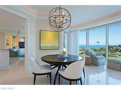 4151 N Gulf Shore BLVD #603 - White coastal breakfast nook in the Provence beach condo in the Park Shore neighborhood of Naples -  Naples Modern Contemporary Homes for Sale