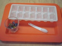 Extension of Spooning Skills  In this activity the child uses a small spoon and places one marble in each section of the ice cube tray.