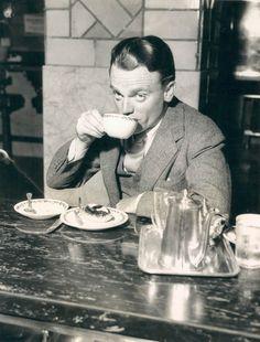 In the days before air travel became popular, almost everyone took the train to get around the United States.  On February 6, 1945 before boarding the Twentieth Century Limited for Chicago, James Cagney stopped in at a restaurant at Grand Central Terminal for a bite to eat. It appears he was enjoying a cup of coffee and a danish. Then he glanced up to see a photographer snapping this picture.: