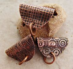 great idea for some metalworked bails----wonder if bails could be made like this out of leather