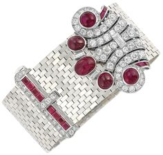 Retro White Gold, Platinum, Ruby and Diamond Slide Buckle Bracelet with Detachable Cabochon Ruby and Diamond Clip. The wide white gold brickwork bracelet centering a platinum and diamond-set clasp edged by 8 square-cut rubies approximately 1.00 ct., the stylized scrolled platinum clip embellished by 5 oval and round cabochon rubies, set with 78 round and 3 baguette diamonds approximately 4.40 cts., edged by 8 calibre-cut rubies, circa 1940 & 1935, clip detachable. Via Doyle New York.