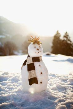 Snowman in field