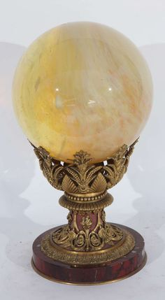 19th Century French, Dore Bronze Rouge Marble Stand with an Opalescent Glass Orb | From a unique collection of antique and modern desk accessories at https://www.1stdibs.com/furniture/more-furniture-collectibles/desk-accessories/