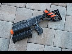 This is a modified Demolisher missile launcher attached to a Nerf Retaliator shell. Modified Nerf Guns, Nerf Mod, Cool Masks, Hand Guns, Water Guns, Dinosaur Drawing, Art Pics, Fallout, Weapons