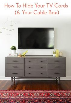 How to hide those unsightly cords hanging from your wall-mounted TV. (via Young House Love) Living Tv, My Living Room, Home And Living, Young House Love Living Room, Tv Stand Ideas For Living Room, Hide Cable Box, Hide Cables, Tv Cable, Hide Tv Wires