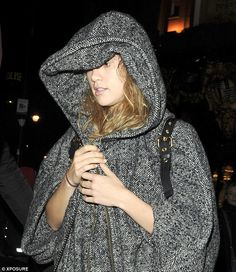 Going under-cover: Make-up-free Suki Waterhouse made an effort to go incognito as she step...