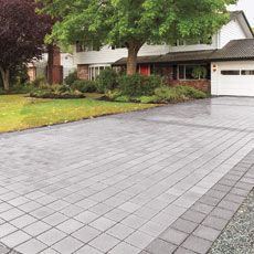 Permeable pavers - they allow the water to drain down through the gaps between them, into a bed of crushed stone, where it seeps into the soil.