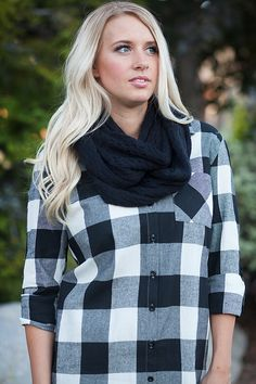 Sophia Kaye - Women's Clothing Boutique- To say we love black and white is an understatement. Black and white plaid? Shut. The. Front. Door. This tunic is the bomb.com and you need it in your life! Pair with your favorite boots and scarf and you are dressed to impress! Can also double as a dress. Great quality! Features 3/4 buttoned sleeve, black buttons, high-low cut. Pictured with our Honeycomb Fringe Scarves.